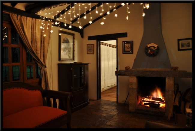 Cozy Home Fireplace by Flickr User MomentCaptured1, CC License = Attribution