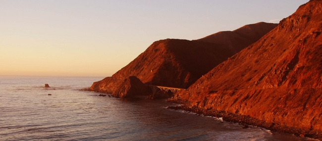 Highway 1 at Sunset by Flickr User namealus, CC License = Attribution, Noncommercial, No Derivative Works