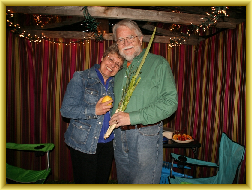 Mary & Steve in the Sukkah with the Lulav 10-09-2012