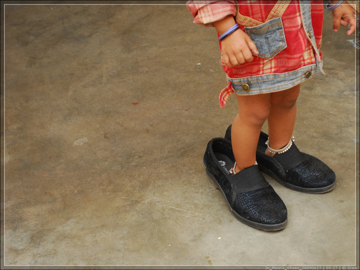 In Mom's Shoes by Flickr User Impulses, CC License = Attribution, Noncommercial, No Derivative Works