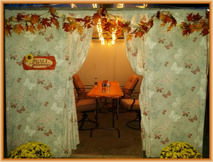 The front of our 2014 Sukkah before all the people gathered in and before food filled the tables. It's a welcoming place for a young couple and their new little baby. Cellphone image by Crystal A Murray. CC License = Attribution, Noncommercial, Share Alike